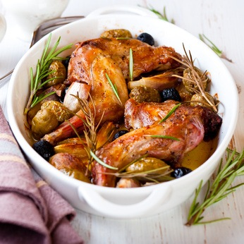 Oven baked rabbit legs with olives and rosemary
